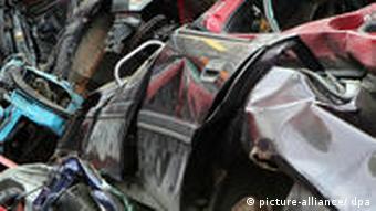 A scrap heap with mangled cars
