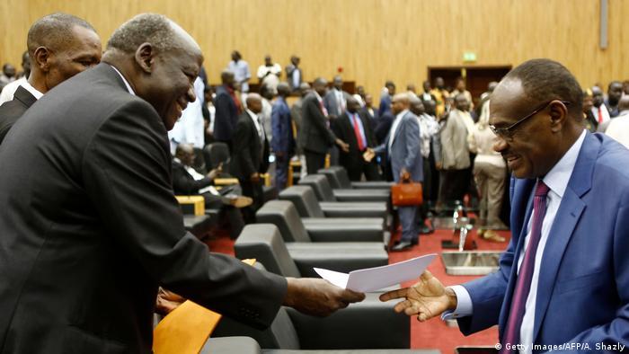 Sudan, Khartoum, men passing documents to one another