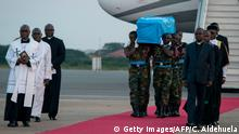 Ghanaian soldiers carry the coffin of late Ghanaian diplomat Kofi Atta Annan on the tarmac of Kotoka International Airport in Accra on September 10, 2018. - Annan's body will remain at Accra Conference Centre until the burial ceremony that will take place on September 13 in Accra. Kofi Annan born in Kumasi in 1938 died on August 18, 2018 in Switzerland at the age of 80 after a short illness. (Photo by CRISTINA ALDEHUELA / AFP) (Photo credit should read CRISTINA ALDEHUELA/AFP/Getty Images)