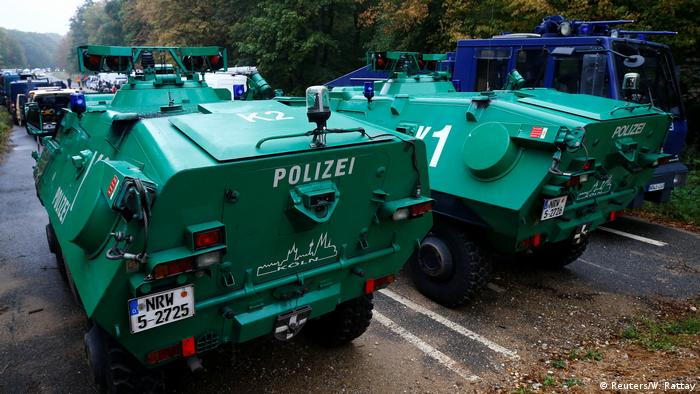 Police bring armored vehicles and water cannons to the protest site in Hambach Forest