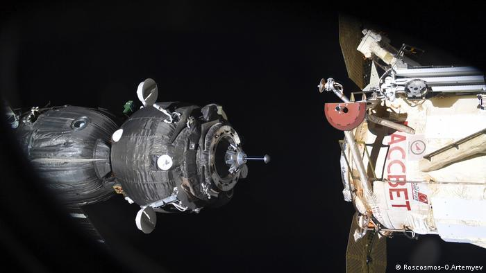 Archive image of a Soyuz spacecraft docking with the International Space Station (Roscosmos–O.Artemyev)