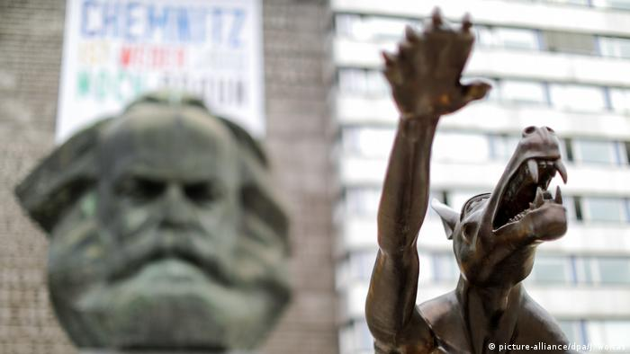 Wolf showing Hitler salute with Karl Marx in background