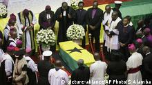 13.09.2018+++ Clergymen pray over the coffin of former U.N. Secretary-General Kofi Annan, draped with the Ghana flag, during a state funeral at the Accra International Conference Center in Ghana Thursday, Sept. 13, 2018. After days of lying in state for mourners to pay their respects the body of Kofi Annan, who died in August in Switzerland at age 80, will be buried Thursday after a final funeral ceremony. (AP Photo/Sunday Alamba)  