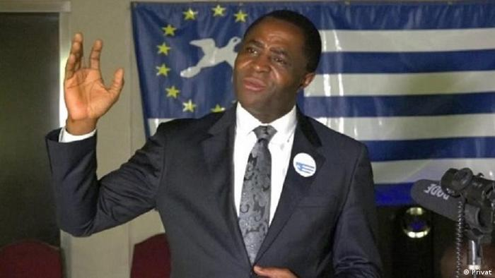 Sisiku Julius Ayuk Tabe gives a speech with the Ambazonian flag in the background