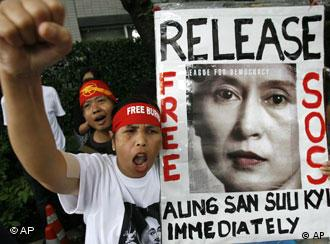 Protestor with picture of Suu Kyi