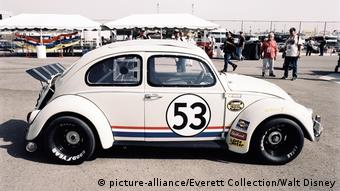 Herbie sits on the pavement