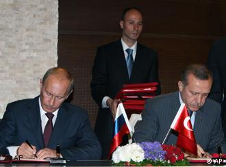 Russian Prime Minister Vladimir Putin, left, and his Turkish counterpart Recep Tayyip Erdogan signing the agreement in Ankara.