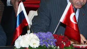 Russian Prime Minister Vladimir Putin, left, and his Turkish counterpart Recep Tayyip Erdogan sign an agreement on constructing part of the South Stream Pipeline through waters in the Black Sea, in Ankara, Turkey, Thursday, Aug. 6, 2009. Putin said Thursday a newly signed deal to build a gas pipeline through Turkish waters is vital to European energy security.( AP Photo/Burhan Ozbilici)