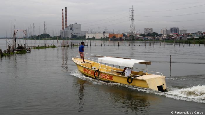 A rescue boat is pictured near the shoreline of Laguna de Bay