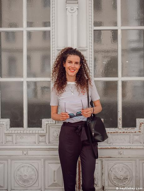 Fashion blogger Mia Marjanovic in black pants and a black and white stripped top