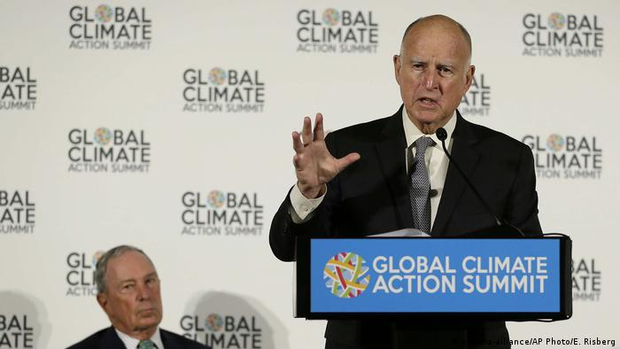 California Governor Jerry Brown speaks as Michael Bloomberg, left, listens during a news conference at the Global Action Climate Summit Thursday, Sept. 13, 2018, in San Francisco