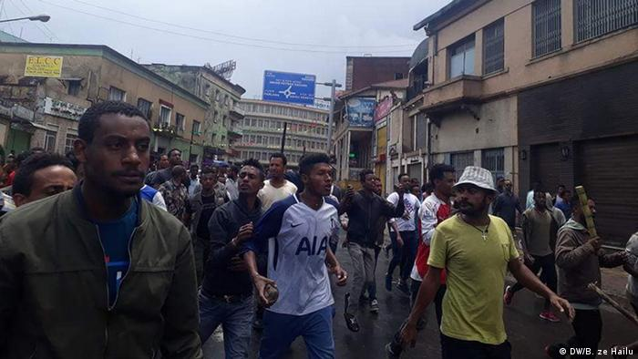 Young men seen walking through the streets of Addis Ababa