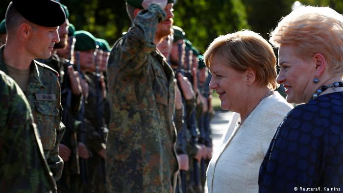 German Chancellor Angela Merkel addresses German troops of the NATO enhanced Forward Presence battle group with Lithuanian President Dalia Grybauskaite in Rukla military base, Lithuania (Reuters/I. Kalnins)