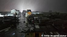 15.09.2018 TUGUEGARAO, PHILIPPINES - SEPTEMBER 15: Rains cover the city as strong winds batter houses and buildings lying on the path of Typhoon Mangkhut as it makes landfall on September 15, 2018 in Tuguegarao city, northern Philippines. Mangkut is expected to land Saturday and officials have ordered evacuations and school closures with millions of people in the storms predicted path. The category five storm would be the strongest to hit this year, with wind gusts already at 270 kilometres an hour. (Photo by Jes Aznar/Getty Images)
