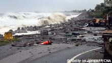 15.09.2018 +++ TOPSHOT - This CNA handout picture taken on September 15, 2018 shows debris on a road brought by large waves in Taitung county, eastern Taiwan, as typhoon Mangkhut approaches the southern Taiwan. (Photo by CNA PHOTO / CNA / AFP) / Taiwan OUT - China OUT - Hong Kong OUT - Macau OUT (Photo credit should read CNA PHOTO/AFP/Getty Images)