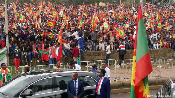 A crowd waves Oromo Liberation Front flags