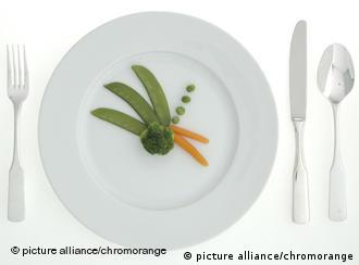 Plate with broccoli, carrot and peas