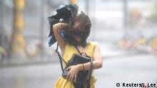 16.09.2018 +++ A woman walks in the rainstorm as Typhoon Mangkhut approaches, in Shenzhen, China September 16, 2018. REUTERS/Jason Lee