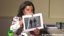 MOSCOW, RUSSIA - SEPTEMBER 13, 2018: RT Editor-in-Chief Margarita Simonyan shows an image of two men during an interview with Alexander Petrov and Ruslan Boshirov, who are suspected by the British authorities of poisoning former GRU officer Sergei Skripal and his daughter Yulia in Salisbury, United Kingdom in March 2018. RT video screengrab/TASS Foto: Tass/TASS/dpa  