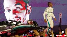 Formula One F1 - Singapore Grand Prix - Marina Bay Street Circuit, Singapore - September 16, 2018 Mercedes' Lewis Hamilton celebrates after winning the race REUTERS/Edgar Su
