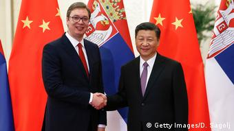 Serbian Prime Minister Aleksandar Vucic shaking hands with Chinese President Xi Jinping in China.