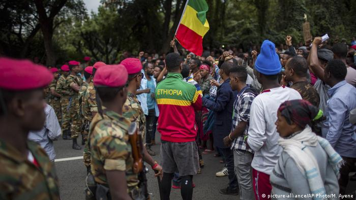 Ethiopian soldiers form a line in front of protesters