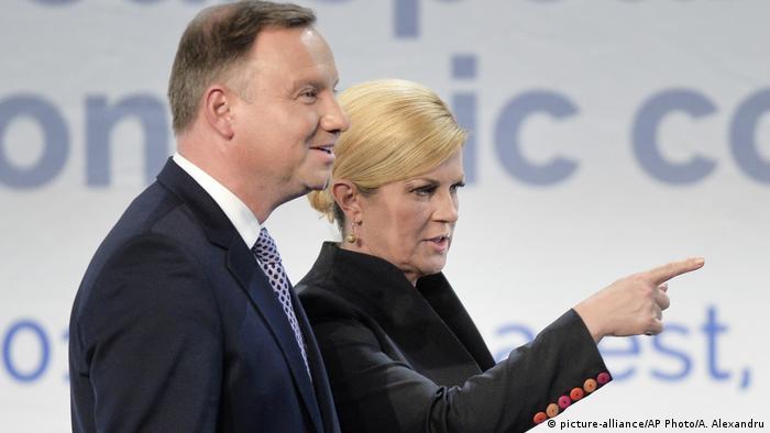 Croatian President Kolinda Grabar-Kitarovic, right, gestures next to Polish President Andrzej Duda