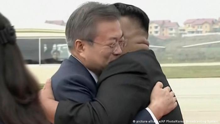 South Korean President Moon Jae-in, left, hugs North Korean leader Kim Jong Un