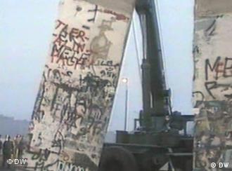 The Berlin wall being toppled