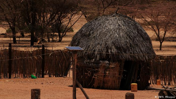 A traditional house in Turkana, Kenya, with a solar panel out front