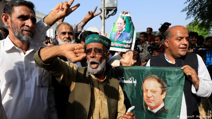 A supporter of former Prime Minister Nawaz Saharif reacts as he celebrate with others following the court's decision in Islamabad, Pakistan, September 19, 2018