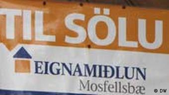 A sign showing a house for sale near Reykjavik