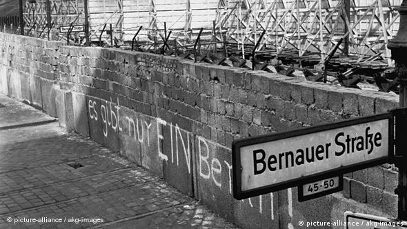 the Berlin Wall with graffiti saying There's only one Berlin