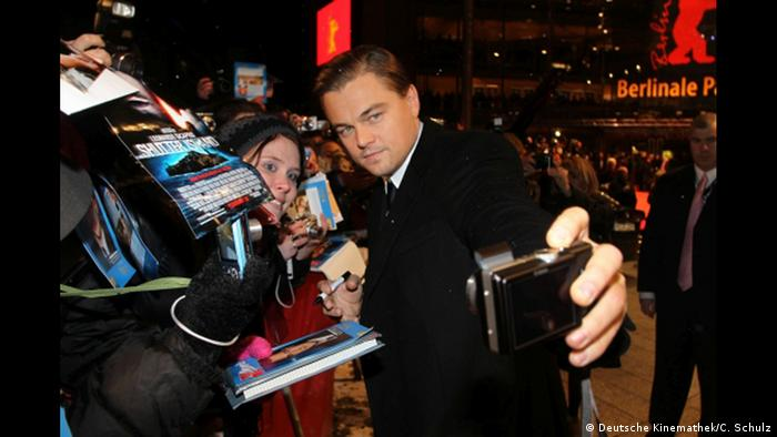 Leonardo DiCaprio taking a selfie with a fan (Deutsche Kinemathek/C. Schulz)