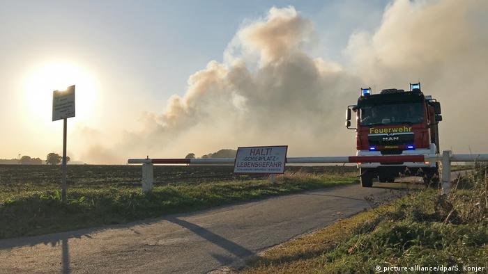 Fire truck near Meppen against background of smoke