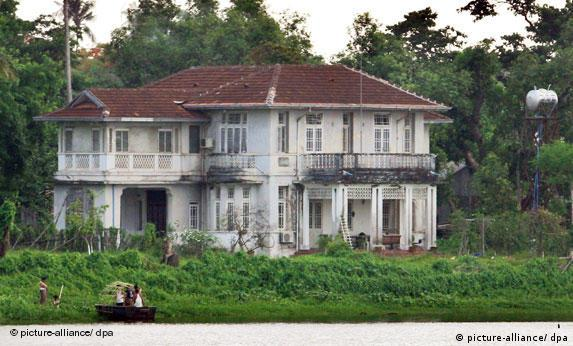 A photograph made available on 8 May 2009 showing a small boat stopping along a lake at the rear of Aung San Suu Kyi's home in Yangon, Myanmar.