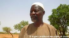 """Yacouba Sawadogo is known as """"the man who stopped the desert"""". Starting around 1980 during a phase of severe drought, he has successfully created an almost 40-hectare forest on formerly barren and abandoned land. Today, it has more than 60 species of trees and bushes and is arguably one of the most diverse forests planted and managed by a farmer in the Sahel. For turning barren land into forest and demonstrating how farmers can regenerate their soil with innovative use of local and indigenous knowledge."""