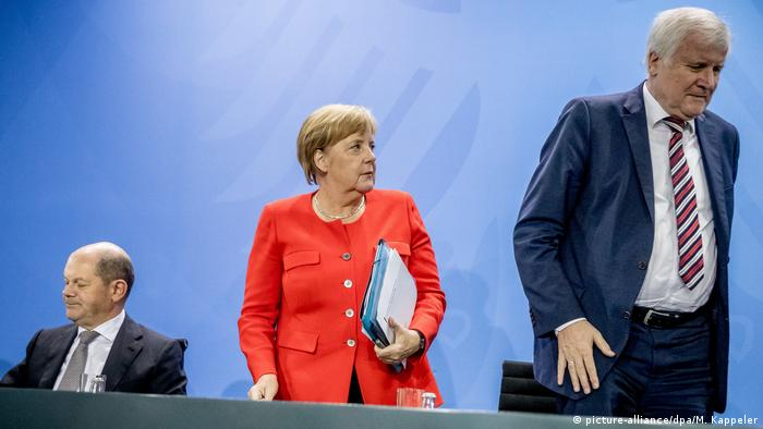 German Chancellor Angela Merkel with Olaf Scholz and Horst Seehofer at a press conference
