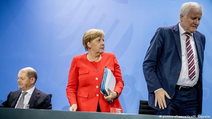 Scholz, Merkel, Seehofer