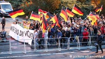 Demonstrators with German flags