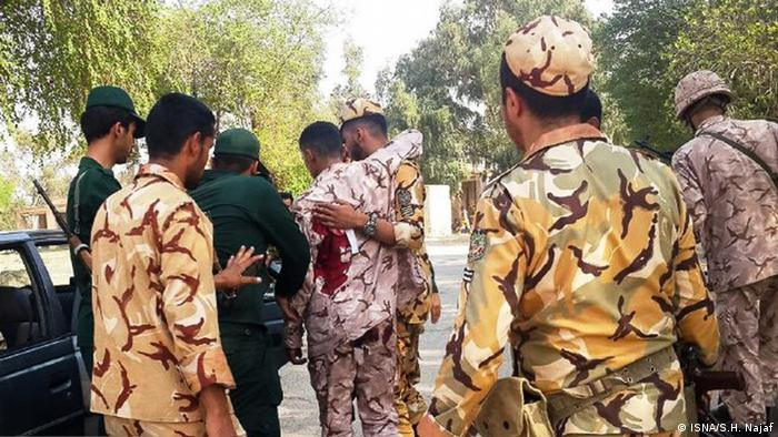 military members carry a bleeding individual (ISNA/S.H. Najaf)