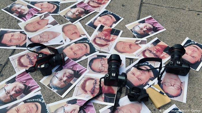 Photos at a memorial to murdered Mexican journalists (Getty Images/AFP/Y. Cortez)