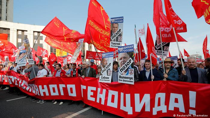 Supporters of left-wing political parties in Moscow hold a red banner reading Against pension genocide during a rally against the pension reform