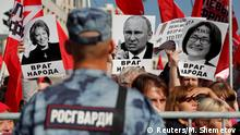 Supporters of left-wing political parties and movements hold placards depicting Russian Federation Council Speaker Valentina Matviyenko, President Vladimir Putin and Central Bank Governor Elvira Nabiullina during a rally against the pension reform, which envisage raising the retirement age, in Moscow, Russia September 22, 2018. The placards read Public enemy. REUTERS/Maxim Shemetov TPX IMAGES OF THE DAY