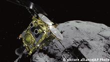 A JAXA graphic showing an asteroid and asteroid explorer Hayabusa2 (picture alliance/AP Photo)