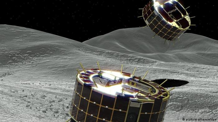 An artistic depiction of rovers landing on the Ryugu asteroid
