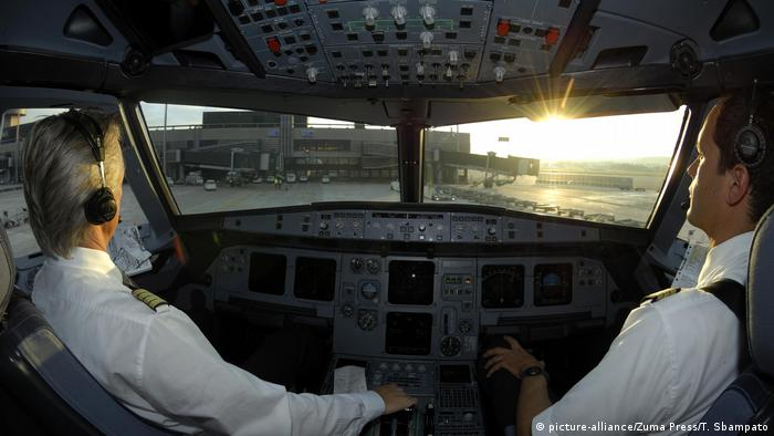 Pilots in a cockpit after landing an Airbus 321