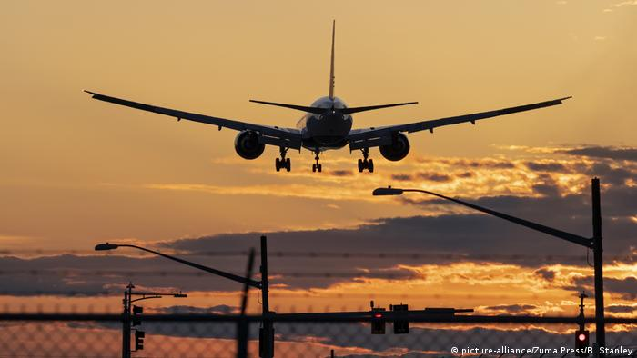 A Boeing 777 jet airliner lands at sunset at Vancouver International Airport in Canada