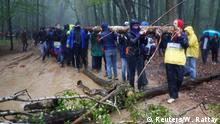 People build a barricade in the forest as they protest against German utility and power supplier RWE