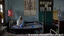 An Indian tuberculosis patient rests on a bed at a TB hospital on World Tuberculosis Day in Gauhati, India, Saturday, March 24, 2018. Earlier this month Indian Prime Minister Narendra Modi launched a campaign to fast-track the India's response to tuberculosis, which is now the world's leading infectious killer. (AP Photo/Anupam Nath) |